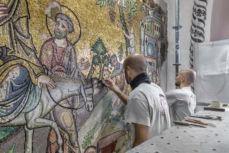 restorers working on mosaics in Bethlehem