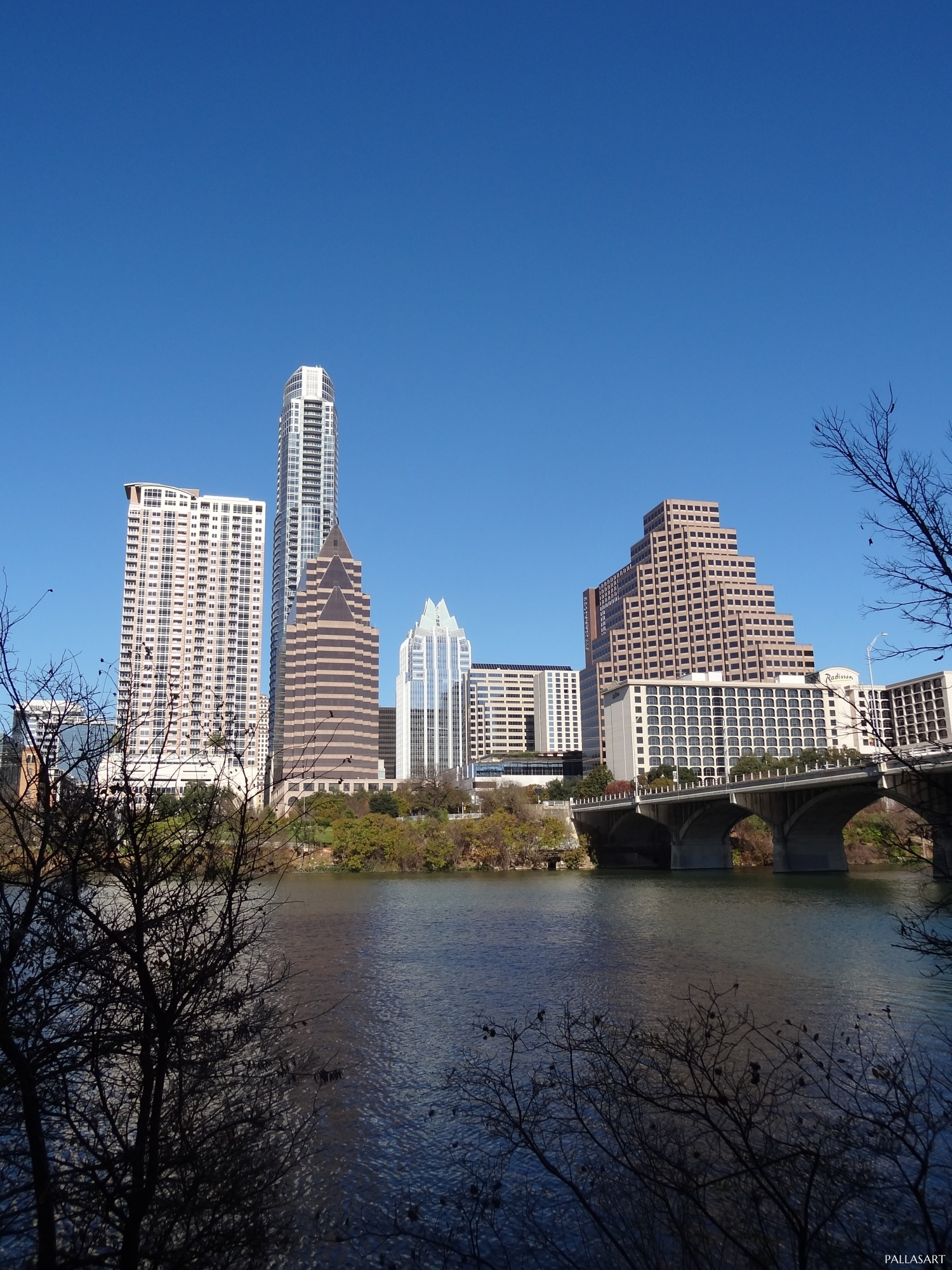 View of Austin Downtown from South Shore just west of Congress Ave. Bridge