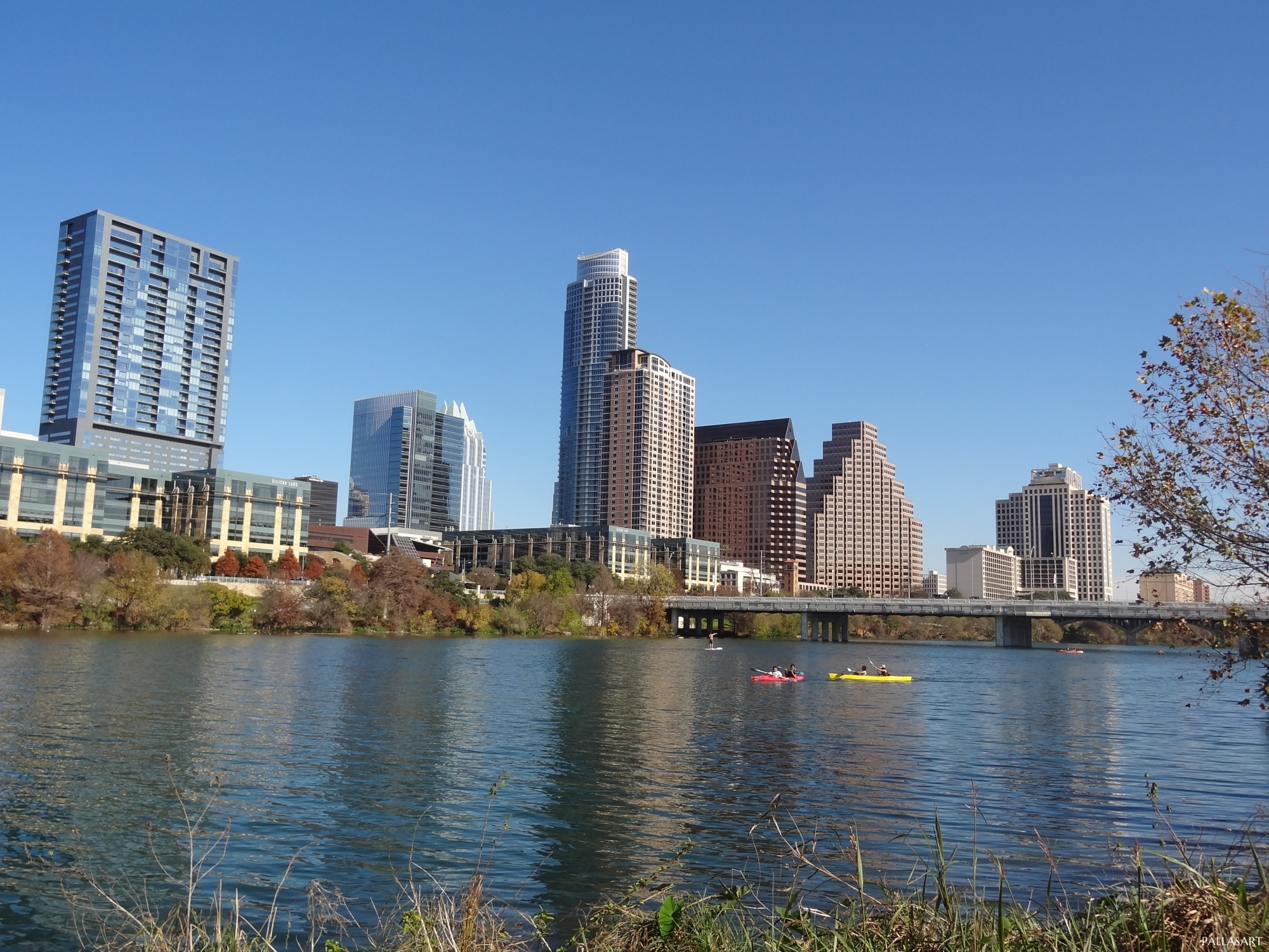 Canoes on Lady Bird Lake with Downtown Austin Skyline
