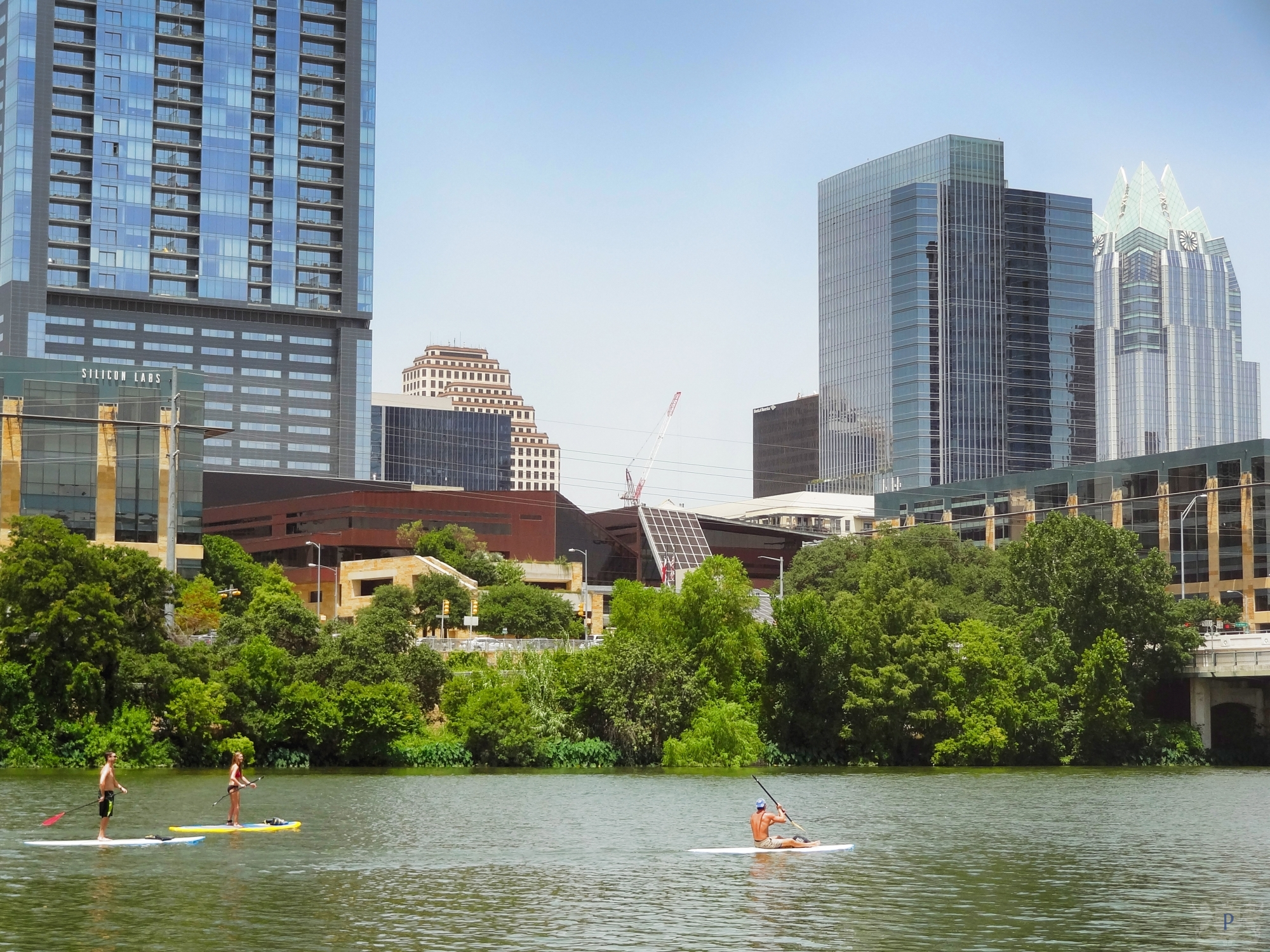 Austin City Hall with Stand Up Paddleboarders on Lady Bird Lake