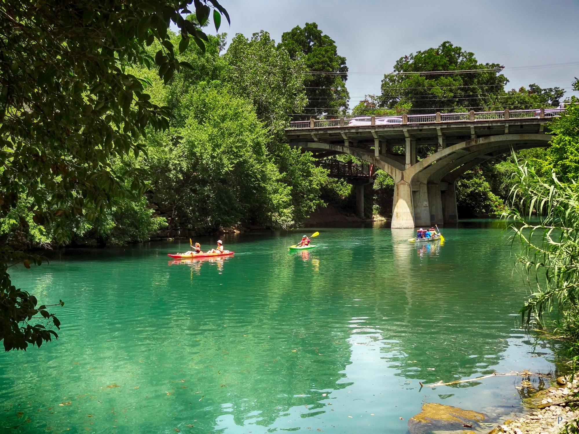 Kayaks On Barton Creek With Barton Springs Rd Bridge