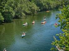 Kayaks and SUPs on Barton Creek in Austin