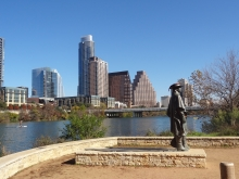 Austin Downtown behind Stevie Ray Vaughan statue