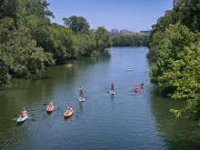 Kayakers and SUPs on Barton Creek in Austin