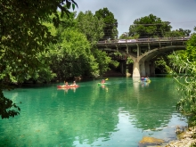 Kayaks on Barton Creek with Barton Springs Rd. Bridge
