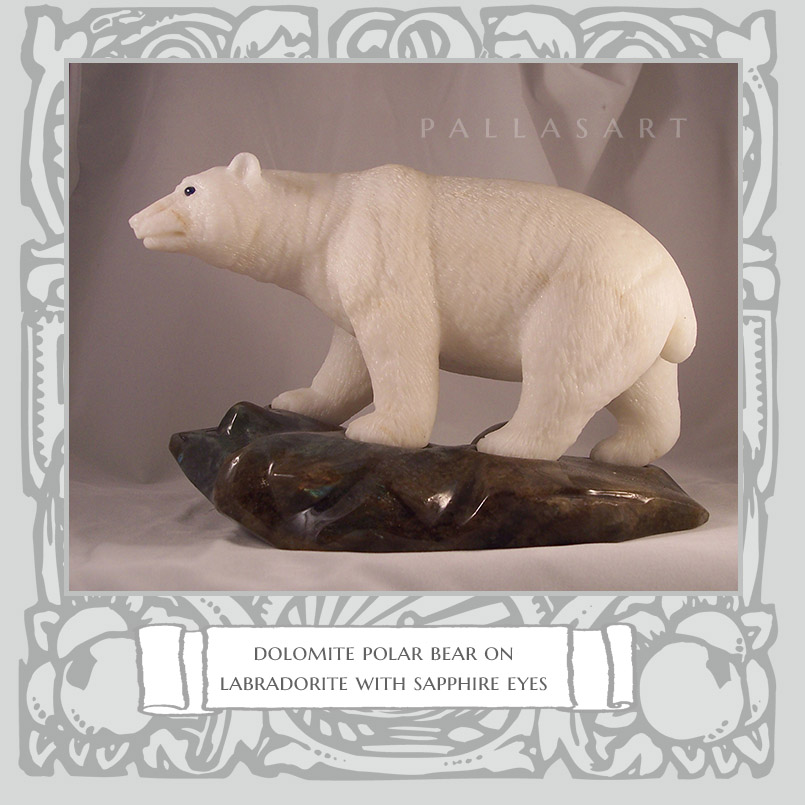 dolomite polar bear on labradorite with sapphire eyes